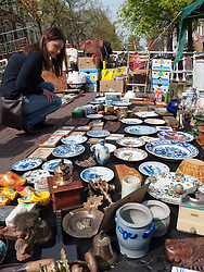 Saturday antiques market beside canals in Delft in The Netherlands