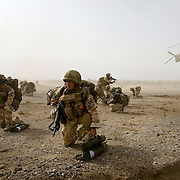 British soldiers of 3rd Battalion The Parachute Regiment take up fire positions after charging off of a Chinook Ch-47 helicopter in an airborne assault as part of Operation 'Southern Beast'. Kandahar Province, Afghanistan on the 3rd of August 2008.