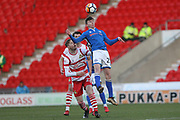 Dan Adshead heads clear during the The FA Cup 3rd round match between Doncaster Rovers and Rochdale at the Keepmoat Stadium, Doncaster, England on 6 January 2018. Photo by Daniel Youngs.