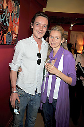 The EARL OF LICHFIELD and LADY HENY CONYNGHAM at a party to celebrate the publication of Joth Shakerley's book 'Pregnant Women' held at 598a Kings Road, London SW6 on 20th May 2009.