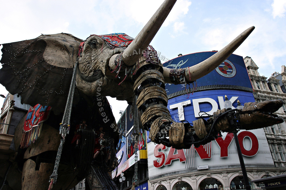 The gigantic mechanical elephant walking through Piccadilly Circus in central London, on Friday, May 5, 2006. The Sultan's Elephant show, for the first time in London is a magical, and unique in the world, theatrical show across the streets, performed by an international French company - Royal De Luxe - specialised in constructing and giving 'life' to enormous mechanical puppets. The Sultan's Elephant is the story of a Sultan dreaming of a little girl that travels through time. **ITALY OUT**