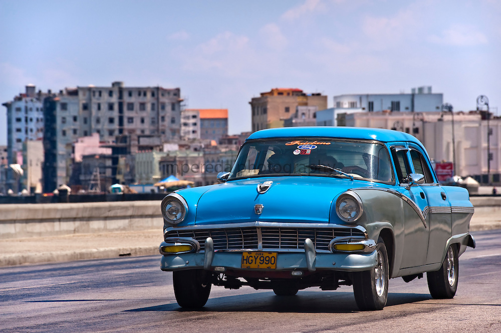 CUBA (La Habana). 2009. Old car in the Malecon. Economic blockade forces cuban people to use all their habilities to survive.