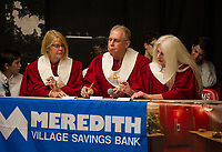 """The """"Red Robes"""" Congregational Church team of Jean Clark, Bob Hunt and Ruth Gill compete during the Lakes Region Scholarship Foundation's 19th annual Spelling Bee on Thursday evening at Laconia High School.  (Karen Bobotas/for the Laconia Daily Sun)"""