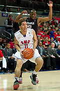 DALLAS, TX - FEBRUARY 6: Nic Moore #11 of the SMU Mustangs drives to the basket against the Temple Owls on February 6, 2014 at Moody Coliseum in Dallas, Texas.  (Photo by Cooper Neill) *** Local Caption *** Nic Moore
