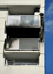 © licensed to London News Pictures. FULHAM, UK  13/09/11. Six fire engines and around 30 firefighters were called to a flat fire on Lillie Road in Fulham this afternoon..The fire damaged around half of a five roomed flat on the sixth floor of the 17 storey block and around 25 people left the building before the Brigade arrived. The Brigade's 999 control officers received over 20 calls to the incident. No one was injured. Photo credit should read Stephen SImpson/LNP