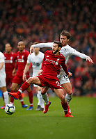 Football - 2018 / 2019 Premier League - Liverpool vs. Burnley<br /> <br /> Adam Lallana of Liverpool and Jeff Hendrick of Burnley at Anfield.<br /> <br /> COLORSPORT/LYNNE CAMERON