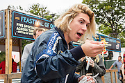 Queens, NY - October 2, 2016. Max Harwood of the band Lewis del Mar eating Thai noodle soup from Pata Paplean at The Feastival of Queens at The Meadows festival at Citi Field.