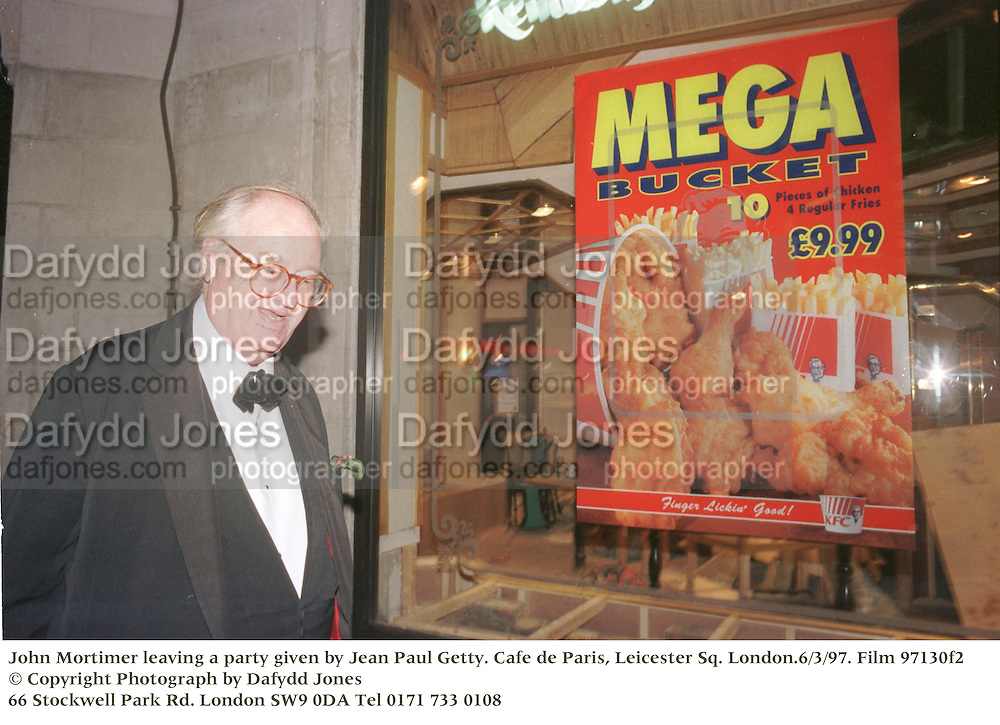 John Mortimer leaving a party given by Jean Paul Getty. Cafe de Paris, Leicester Sq. London.6/3/97. Film 97130f2<br />