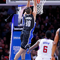 03 December 2014: Orlando Magic guard Evan Fournier (10) goes for the dunk past Los Angeles Clippers center DeAndre Jordan (6) during the Los Angeles Clippers 114-86 victory over the Orlando Magic, at the Staples Center, Los Angeles, California, USA.
