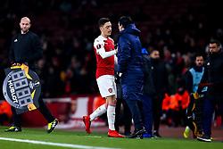 Mesut Ozil of Arsenal shakes hands with Arsenal manager Unai Emery - Mandatory by-line: Robbie Stephenson/JMP - 13/12/2018 - FOOTBALL - Emirates Stadium - London, England - Arsenal v Qarabag - UEFA Europa League group stage