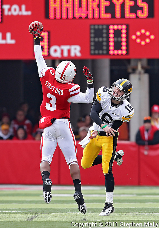 November 25, 2011: Nebraska Cornhuskers safety Daimion Stafford (3) tips a pass attempt by Iowa Hawkeyes quarterback James Vandenberg (16) during the second half of the NCAA football game between the Iowa Hawkeyes and the Nebraska Cornhuskers at Memorial Stadium in Lincoln, Nebraska on Friday, November 25, 2011. Nebraska defeated Iowa 20-7.