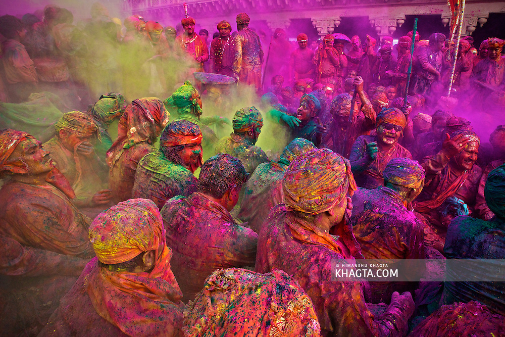 People celebrating the colorful festival of Holi in Nandgaon village of Mathura. .This small village is part of the traditonal Braj Region and comes to life at the event of Holi when people from Barsana and Nand Gaon sit together during Samaaj and sing traditional songs while village people throw colors on each other.