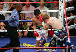 Manny Pacquiao knocks down Ricky Hatton at the end of round one of their Light Welterweight title fight at the MGM Grand, Las Vegas , Nevada, 2nd May 2009.