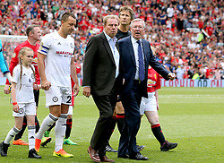 John Terry (left), Harry Redknapp (centre) and Sir Alex Ferguson (right) walk out before Michael Carrick's Testimonial match at Old Trafford, Manchester.