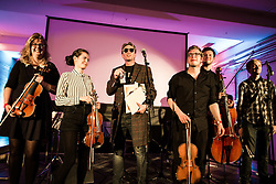 "© Licensed to London News Pictures . 14/08/2015 . Manchester , UK . Poet MIKE GARRY (centre) performs single "" St Anthony : an ode to Anthony H Wilson "", written by Garry and composer Joe Duddell , with the Cassia String Quartet . A tribute to Tony Wilson at Old Granada Studios . Photo credit : Joel Goodman/LNP"