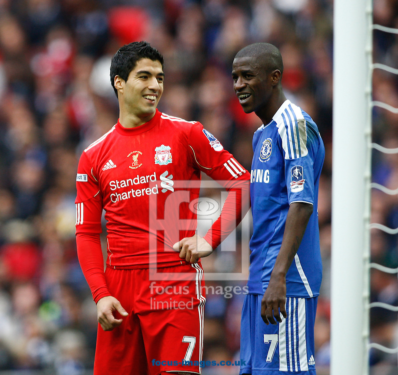 Picture by Andrew Tobin/Focus Images Ltd. 07710 761829. 5/5/12. Ramires of Chelsea and Luis Suarez of Liverpool share a joke during the FA Cup Final between Chelsea and Liverpool at Wembley Stadium, London