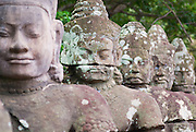 SIEM REAP, CAMBODIA - AUGUST 08, 2008: Exterior of the stone sculptures of the Angkor Thom in Siem Reap, Cambodia.
