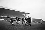 Irish Rugby Football Union, Ireland v New Zealand, Tour Match, Landsdowne Road, Dublin, Ireland, Saturday 7th December, 1963,.7.12.1963, 12.7.1963,..Referee- H Keenen, Rugby Football Union, ..Score- Ireland 5 - 6 New Zealand, ..Irish Team, ..T J Kiernan, Wearing number 15 Irish jersey, Full Back, Cork Constitution Rugby Football Club, Cork, Ireland,..J Fortune, Wearing number 14 Irish jersey, Right Wing, Clontarf Rugby Football Club, Dublin, Ireland,..P J Casey, Wearing number 13 Irish jersey, Right Centre, University College Dublin Rugby Football Club, Dublin, Ireland, ..J C Walsh,  Wearing number 12 Irish jersey, Left Centre, University college Cork Football Club, Cork, Ireland,..A T A Duggan, Wearing number 11 Irish jersey, Left Wing, Landsdowne Rugby Football Club, Dublin, Ireland,..M A English, Wearing number 10 Irish jersey, Stand Off, Landsdowne Rugby Football Club, Dublin, Ireland, ..J C Kelly, Wearing number 9 Irish jersey, Captain of the Irish team, Scrum Half, University College Dublin Rugby Football Club, Dublin, Ireland,..P J Dwyer, Wearing number 1 Irish jersey, Forward, University College Dublin Rugby Football Club, Dublin, Ireland, ..A R Dawson, Wearing number 2 Irish jersey, Forward, Wanderers Rugby Football Club, Dublin, Ireland, ..R J McLoughlin, Wearing number 3 Irish jersey, Forward, Gosforth Rugby Football Club, Newcastle, England, ..W J McBride, Wearing number 4 Irish jersey, Forward, Ballymena Rugby Football Club, Antrim, Northern Ireland,..W A Mulcahy, Wearing number 5 Irish jersey, Forward, Bective Rangers Rugby Football Club, Dublin, Ireland,  ..E P McGuire, Wearing number 6 Irish jersey, Forward, University college Galway Football Club, Galway, Ireland,  ..P J A O' Sullivan, Wearing  Number 8 Irish jersey, Forward, Galwegians Rugby Football Club, Galway, Ireland,..N A Murphy, Wearing number 7 Irish jersey, Forward, Cork Constitution Rugby Football Club, Cork, Ireland,..New Zealand Team, ..D B Clarke, Wearing number 1 New Zealand Jersey, F