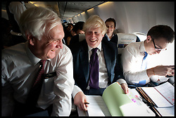 London Mayor Boris Johnson working on the plane to Mumbai from Hyderabad with His Chief of Staff Ed Lister (left) and His Private Secretary Ben Gascoigne (right)  , on the forth day of a six-day tour of India, where he will be trying to persuade Indian businesses to invest in London, Wednesday November 28, 2012. Photo by Andrew Parsons / i-Images