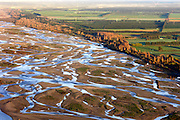 The Stunning Beauty of Braided Rivers<br /> <br /> Most rivers flow in one broad channel of water, but some rivers split into lots of small channels that continually split and join each other to give a braided appearance. These are called braided rivers.<br /> <br /> Braided rivers are usually wide but shallow. They typically form on fairly steep slopes and carry large amount of coarse-grained sediments. When the river&rsquo;s flow decreases, these sediments get deposited on the river bed leaving behind small temporary islands of sands that cause the river&rsquo;s channel to split. Aside from a steep gradient and abundance of sediments, a variable water discharge rate is essential to their formation. Consequently, braided rivers exist near mountainous regions, especially those with glaciers. Braided channels are also found in environments that dramatically decrease channel depth, and hence channel velocity, such as river deltas, alluvial fans and peneplains.          <br /> <br /> Photo shows: The Waimakariri River<br /> &copy;Exclusivepix Media