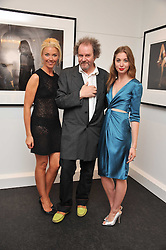Left to right, TAMARA BECKWITH, MIKE FIGGIS and ANOUSHKA BECKWITH at a private view of an exhibition of photographs by Mike Figgis entitled 'Kate & Other Women' held at The Little Black Gallery, 13 A Park Walk, London SW10 on 22nd June 2011.