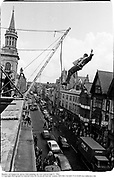 Member od Dangerous sports Club jumping out over Oxford High St. 1983<br />
