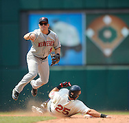 Nick Punto of Minnesota turns a double play as Ryan Garko is forced out at second base..The Minnesota Twins defeated the Cleveland Indians 4-2 on Sunday, July 27, 2008 at Progressive Field in Cleveland.