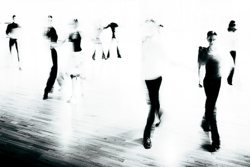 Artistic blurry image of ballroom dancers.