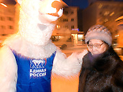 Student dressed as a polar bear for Vladimir Putins party United Russia is trying to convince people on the street to vote them a few days before the Duma elections in Russia. Yakutsk is a city in the Russian Far East, located about 4 degrees (450 km) below the Arctic Circle. It is the capital of the Sakha (Yakutia) Republic (formerly the Yakut Autonomous Soviet Socialist Republic), Russia and a major port on the Lena River. Yakutsk is one of the coldest cities on earth, with winter temperatures averaging -40.9 degrees Celsius.