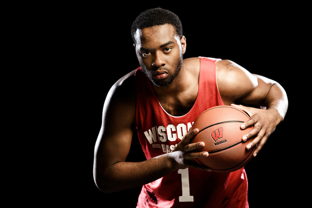 With a wife and three children, along with impressive basketball skills,UW-Madison Badgers' basketball player Marcus Landry is viewed as a role model by his teammates. Kris Ugarriza