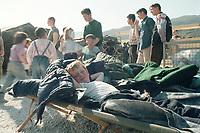 07.04.1999, Mazedonien/Tetovo:<br /> Flüchtlingsjunge aus dem Kosovo freut sich über einen Platz an der Sonne und auf einem Feldbett, Flüchtlingslager der Bundeswehr bei Tetovo , Mazedonien<br /> Refugee child from Kosovo in a refugee champ of the german army, Tetovo, Macedonia <br /> IMAGE: 19990407-01/02-11