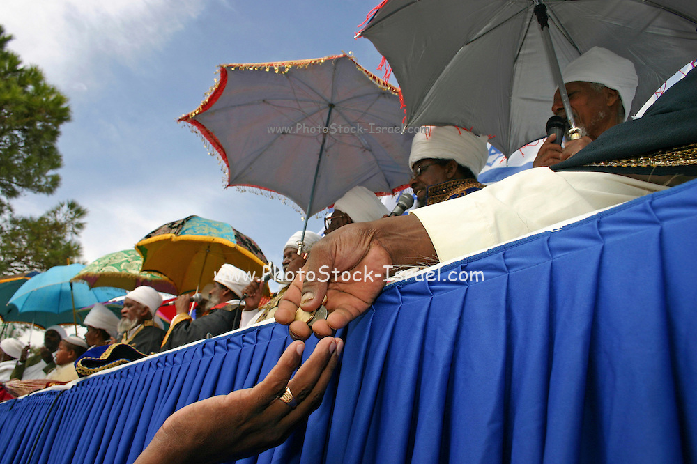Israel, Jerusalem, Ethiopian Kessim at Sigd festival receiving donations from the followers, SIGD, the Ethiopian main religious festival is held annually in Jerusalem and expresses their yearning for Zion and their gratitude for the Torah.  November 2004
