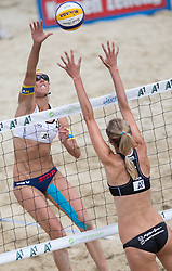 30.07.2014, Strandbad, Klagenfurt, AUT, FIVT, A1 Beachvolleyball Grand Slam 2014, Hauptrunde, im Bild Stefanie Schwaiger (AUT, hinten links), Sarah Pavan (CAN, vorne) // during Main Draw Match of the A1 Beachvolleyball Grand Slam at the Strandbad Klagenfurt, Austria on 2014/07/30. EXPA Pictures © 2014, EXPA Pictures © 2014, PhotoCredit: EXPA/ Johann Groder