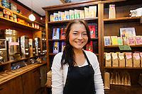 Portrait of female salesperson smiling in coffee shop
