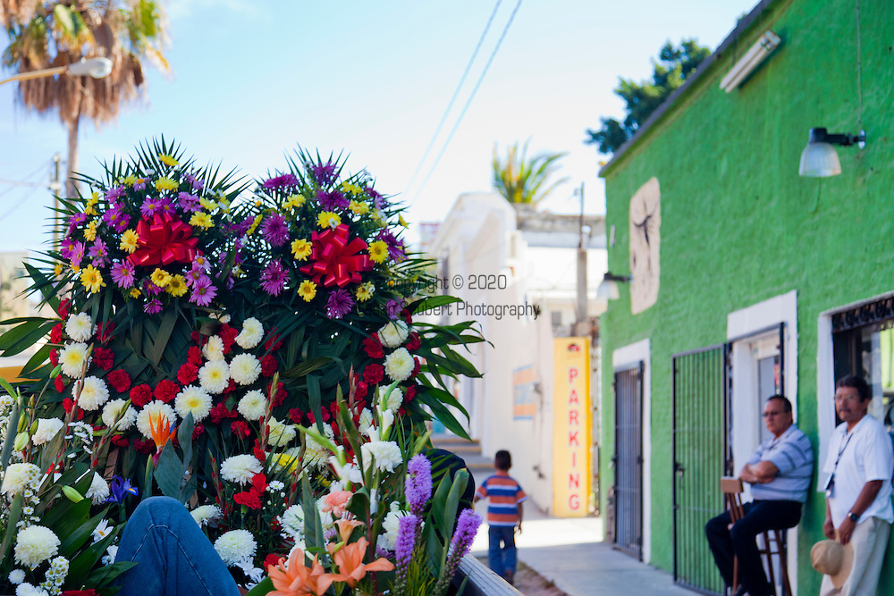 Large flower wreaths in the back of a truck as part of a funeral procession in the city of San Jose del Cabo, Baja, Mexico. The city San José del Cabo is located in Baja California Sur Mexico and is the seat of the municipality of Los Cabos at the south end of the Baja California peninsula.