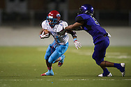 Marquis border (11) of the Carter Cowboys is pushed out of bounds by Cam Henderson (9) of the Lincoln Tigers during a high school football game at Forester Stadium in Dallas, Texas on September 18, 2015. (Cooper Neill/Special Contributor)