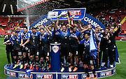 The Bournemouth team celebrate winning the Sky Bet Championship title after the Sky Bet Championship match between Charlton Athletic and Bournemouth at The Valley, London, England on 2 May 2015. Photo by David Charbit.
