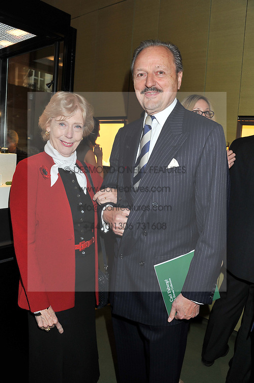 Actor PETER BOWLES and his wife SUE at a private view of  'A Diamond Jubilee Tribute - Faberge From A Private Collection' in aid of the charity Samaritans, held at Wartski, 14 Grafton Street, London on 14th May 2012.