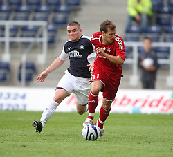 Alex MacDonald &amp; Franz Burhmeier.<br /> Falkirk v FC Vaduz, Europa League Qualifying.<br /> &copy;2009 Michael Schofield. All Rights Reserved.