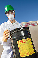 Safety inspector holding hazardous waste