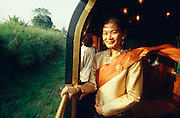 A Stewardess of the Eastern & Oriental Express in Thai silk.