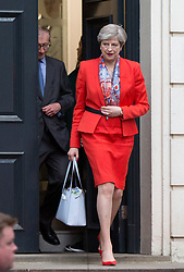 """Prime Minister Theresa May and her husband Philip leave Conservative Party HQ in Westminster, London, after Mrs May said Conservatives will act to ensure """"stability"""" if the Tories are the largest party with the biggest number of votes, as expected."""