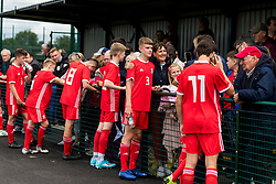 WREXHAM, WALES - Thursday, August 15, 2019: Wales players speak with supporters after the UEFA Under-15's Development Tournament match between Wales and Northern Ireland at Colliers Park. (Pic by Paul Greenwood/Propaganda) Rueben Evans