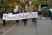 Rally participants marched down Court St., Washington St., University Terrace, and into Baker center to show the campus they care about this national issue during this National Day of Solidarity. Photo by Olivia Wallace