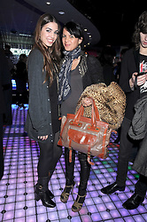 Left to right, AMBER LE BON and LISA MOORISH at the launch party of the Nokia 5800 phone held at PUNK 14 Soho Street, London W1 on 27th January 2009.