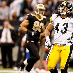 Oct 31, 2010; New Orleans, LA, USA; Pittsburgh Steelers safety Troy Polamalu (43) reacts following a New Orleans Saints first down play during the second half at the Louisiana Superdome. The Saints defeated the Steelers 20-10.  Mandatory Credit: Derick E. Hingle