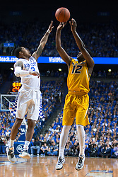Kentucky guard Tyler Ulis, left, contests a shot by Missouri guard Namon Wright in the first half.<br /> <br /> The University of Kentucky hosted the University of Missouri, Wednesday, Jan. 27, 2016 at Rupp Arena in Lexington .