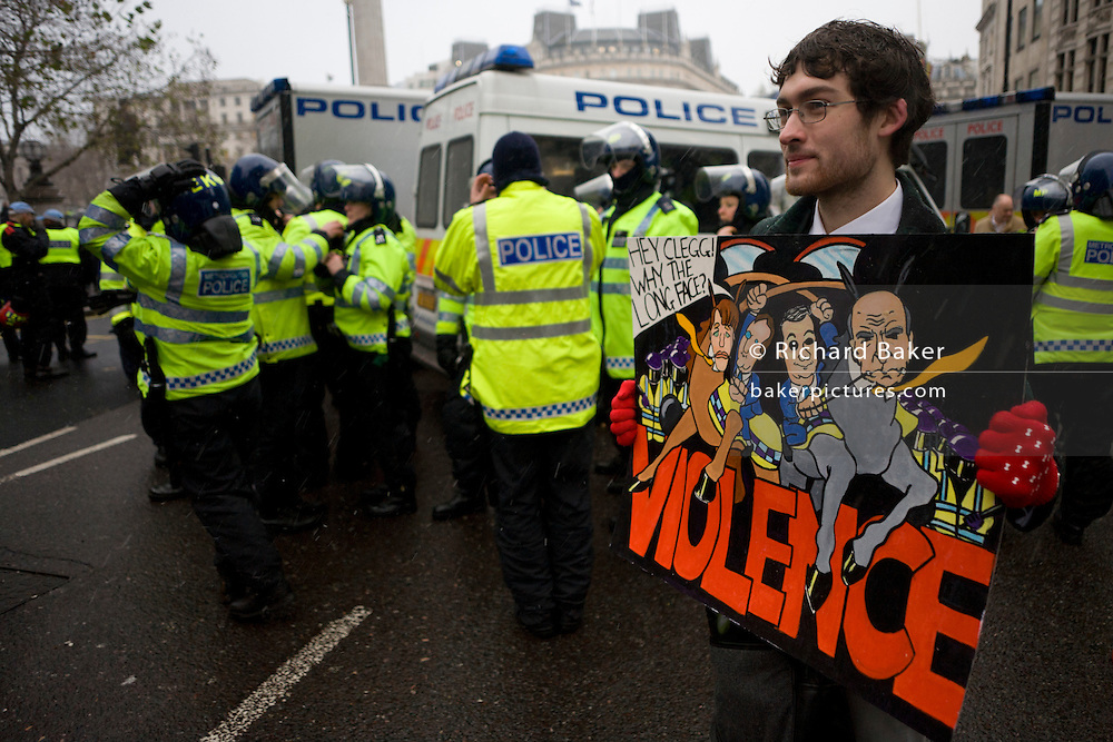 Student protestsd against government education cuts using cartoon picture in Trafalgar Square. Holding a variety of splinter marches that denounce the coalition government's policy of charging extra higher-education tuition fees. There were isolated incidents of violence and skirmishes with police, mostly in central London.