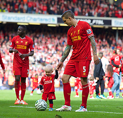 LIVERPOOL, ENGLAND - Sunday, May 11, 2014: Liverpool's Daniel Agger with his son Jamie after the Premiership match at Anfield. (Pic by David Rawcliffe/Propaganda)