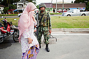 "26 SEPTEMBER 2009 -- PATTANI, THAILAND: Thai soldiers on a Thai army security operation near Krue Se Mosque in Pattani, Thailand, Sept 26. Thailand's three southern most provinces; Yala, Pattani and Narathiwat are often called ""restive"" and a decades long Muslim insurgency has gained traction recently. Nearly 4,000 people have been killed since 2004. The three southern provinces are under emergency control and there are more than 60,000 Thai military, police and paramilitary militia forces trying to keep the peace battling insurgents who favor car bombs and assassination.   PHOTO BY JACK KURTZ"